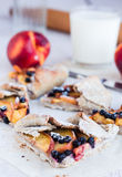 Cut biscuits with peach and blueberry. On a white table Stock Images