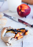 Cut biscuits with peach and blueberry. On a white table Royalty Free Stock Images