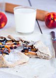 Cut biscuits with peach and blueberry. On a white table with a glass of milk Stock Photography