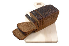 Cut black bread on a board. Royalty Free Stock Images