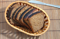 Cut black bread with caraway seeds Stock Photo