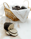 Cut black truffle on old table Stock Photos