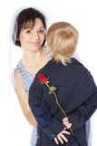Cut boy groom and his cheerful mother bride Stock Photo
