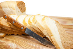 Cut bread. Soft, cut on a table bread, on a white background Royalty Free Stock Images