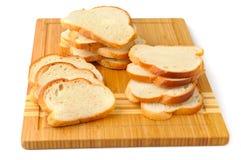 Cut bread on breadboard Royalty Free Stock Photos