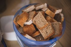Cut bread in  bucket for homeless people Stock Photography