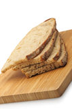 The cut bread on a chopping board Stock Images