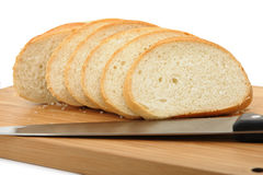 The cut bread on a chopping board with a knife Royalty Free Stock Image