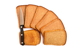 Cut bread with a knife. On a white background Royalty Free Stock Images