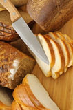 Cut bread and knife Royalty Free Stock Photo