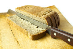 Cut bread knife on wooden kitchen board Stock Photo