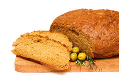 Cut bread, rosemary and olives Royalty Free Stock Photos