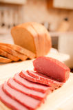 Сut bread and sausage on table Royalty Free Stock Photos