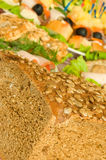 Cut Bread with seeds, meat and canape Royalty Free Stock Image