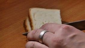 Cut bread for toast. Closeup stock footage