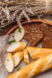 Cut bread in wooden dish Stock Photography