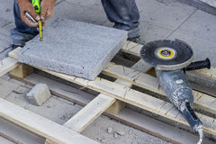 Cut bricks with a angle grinder Royalty Free Stock Images