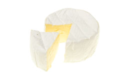 Cut Brie. Round of Brie cheese with w wedge cut out royalty free stock photography
