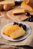 Cut butter cake with cherry Stock Images