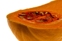 A cut butternut squash against a white background Stock Photography