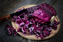 The cut cabbage and kitchen knife Stock Photos