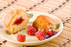 Cut cake with raspberry jam. Cut cake with raspberry jam and fruits Stock Photography