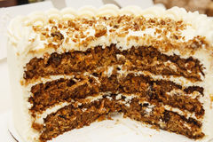 Cut Carrot Cake with Cream Cheese Icing Stock Photo