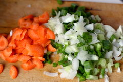 Cut Carrot and Onion. Preparation for meat ball soup Royalty Free Stock Images