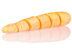 Cut carrot. Over a white reflective background Royalty Free Stock Photo