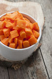 Cut carrot on wooden background Stock Photo