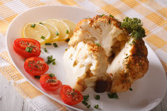 Cut cauliflower baked with cheese close-up on a plate. Horizonta Royalty Free Stock Images