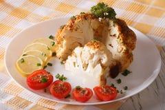 Cut cauliflower baked close-up on a plate. horizontal Stock Photo