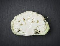 Cut through cauliflower  on stone. Stock Photography