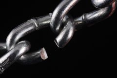Cut chain link on black. Chain with a cut link on a black background Stock Photography
