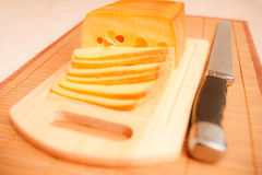 Cut cheese and knife Stock Images