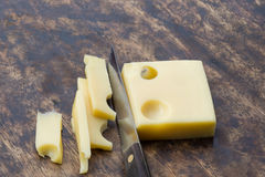 Cut cheese by knife Stock Images