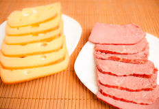 Cut cheese and sausage Royalty Free Stock Image