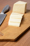 Cut cheese on a wooden board Royalty Free Stock Photo