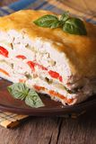 Cut chicken pie with vegetables on a plate macro. Vertical Stock Images