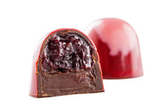 Cut chocolate candy with cherry Stock Photos