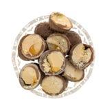 Cut chocolate hazelnut cream truffles in a bowl Royalty Free Stock Photography
