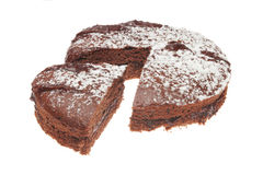 Cut chocolate sponge cake. Chocolate sponge cake with slice cut out Stock Images