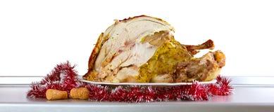 Cut Christmas turkey on the kitchen table Royalty Free Stock Photos