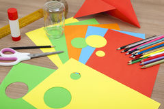 Cut circles of paper. Colorful paper lying on a table to cut of circles Royalty Free Stock Photos