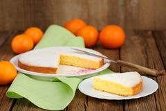Cut clementine pie with clementines and knife on wooden backgrou Royalty Free Stock Images