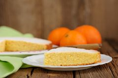 Cut clementine pie with clementines on wooden background Royalty Free Stock Image