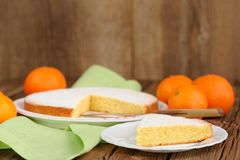 Cut clementine pie with clementines on wooden background Stock Image
