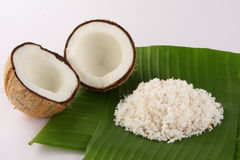 Cut coconuts with coconut leaves and Shredded coconut served in banana leaf. Stock Images