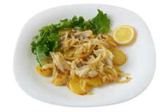Cut codfish with fried potato and onion stock photography