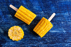 Cut corn on the cob on a stick Stock Image